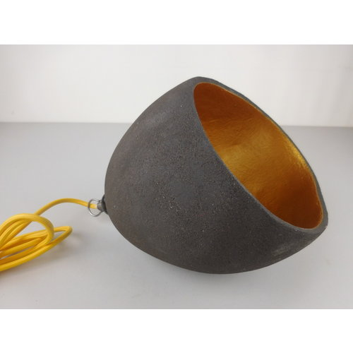 ChiaroEscuro-design The handmade ceramic lighting gives a very nice light through the combination of the black clay with the color. . It is much more than a beautiful design. It is a mood lamp with character that will definitely excel in your interior.