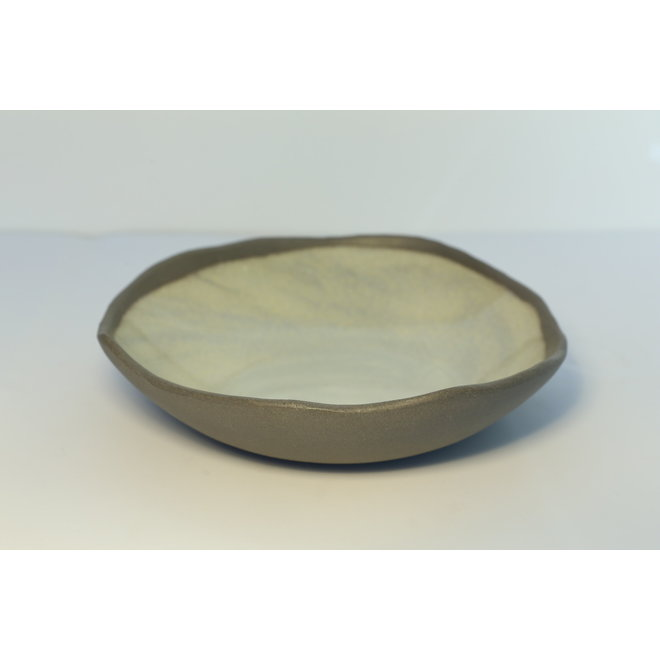 A plate with style, playful and spontaneously made of gray clay and finished with green glaze