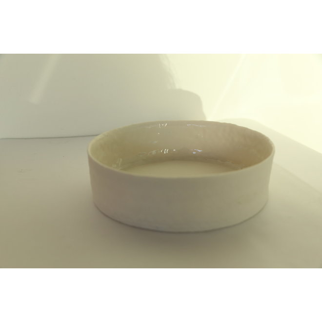 Handmade collection porcelain dish and bowl with a shiny transparent glaze finished on the inside.