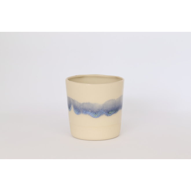 Ceramic handmade espresso cup of beige cast clay with a green and blue edge