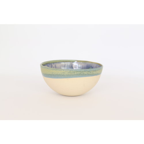 LS-design Bowl handmade in beige cast clay finished with a green, blue edge.