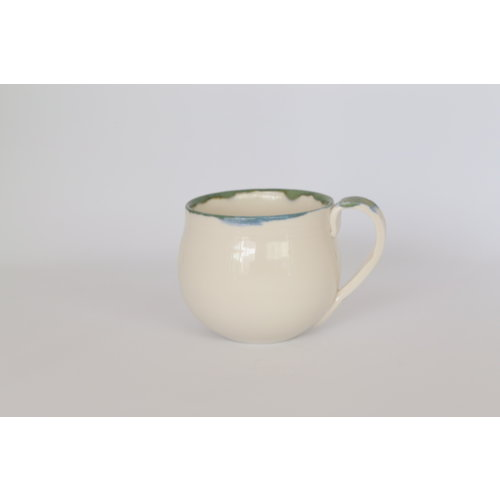 LS-design Elegantly turned porcelain bag with a straight saucer with a green corner