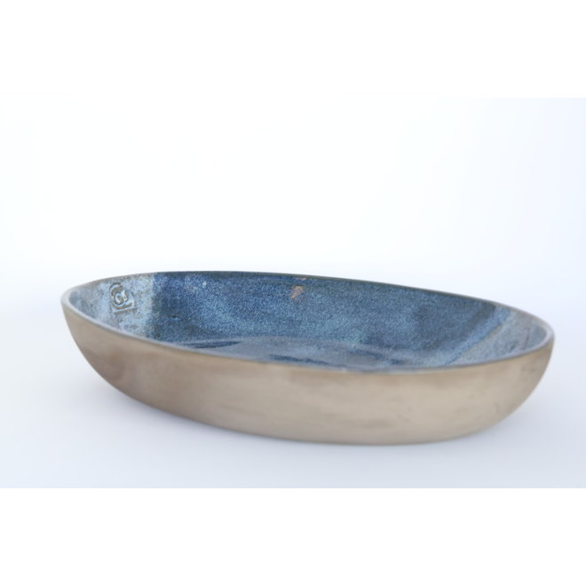 Scale made in a gray chamotte clay and finished with a beautiful blue glaze in two shades
