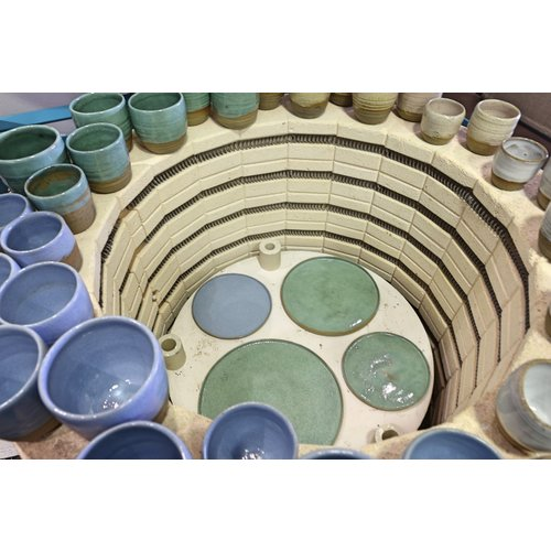 ARTISANN-design With the turntable handmade cup of natural clay with a beautiful blue high-firing glaze.