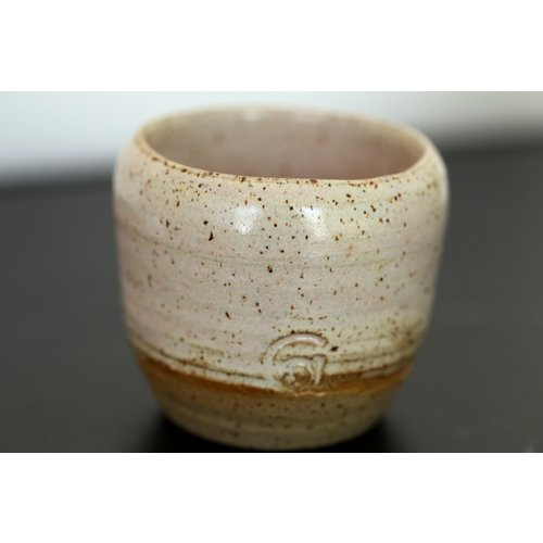 ARTISANN-design With the turntable handmade cup with speckled Pottery-clay and a beautiful opal white high firing glaze.