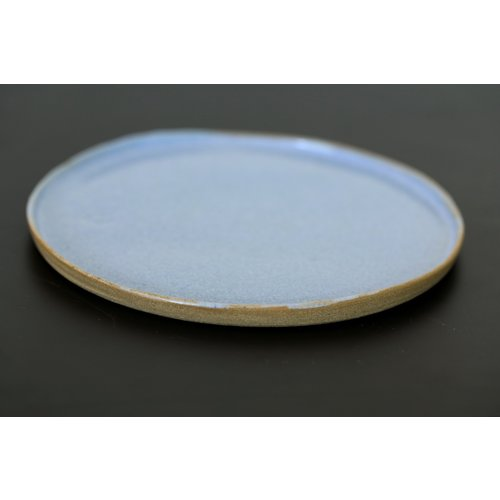 ARTISANN-design With the turntable handmade plate of natural clay with a beautiful blue high-firing glaze.
