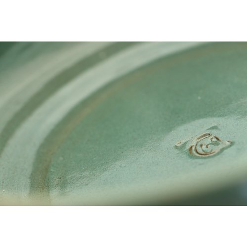 ARTISANN-design With the turntable handmade scale of natural clay with a beautiful green high-firing glaze.