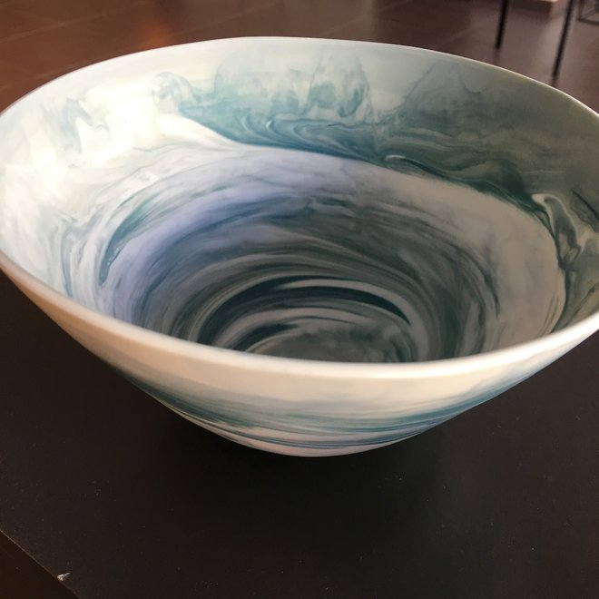 Porcelain bowl with blue-gray hues turned in the mold while rotating