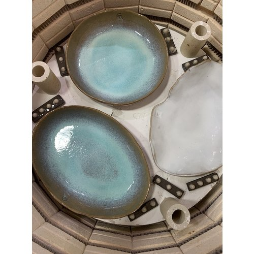 ARTISANN-design In the mold laid oval bowl of Belgian clay with a beautiful Floating-Blue highly fired glaze.