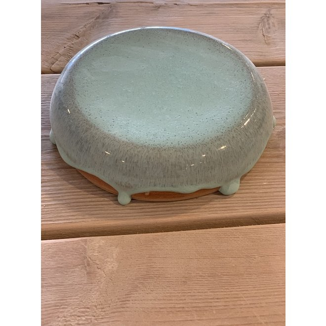 With the turntable handmade presentation stone of Englisch speckled Pottery Clay with a beautiful Floating lightblue turkis high-firing glaze.