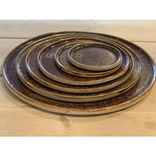 ARTISANN-design With the turntable handmade plate of speckled Pyriet clay with a beautiful Floating orange-brown white high-firing glaze.