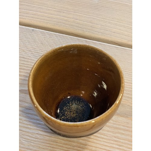 ARTISANN-design With the turntable handmade cup of speckled Pyriet clay with a beautiful Floating orange brown white high-firing glaze.