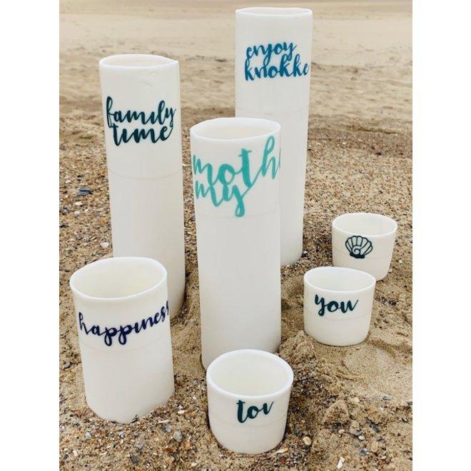 """""""My Knokke"""" speak for themselves in a unique porcelain vase in cylinder form"""