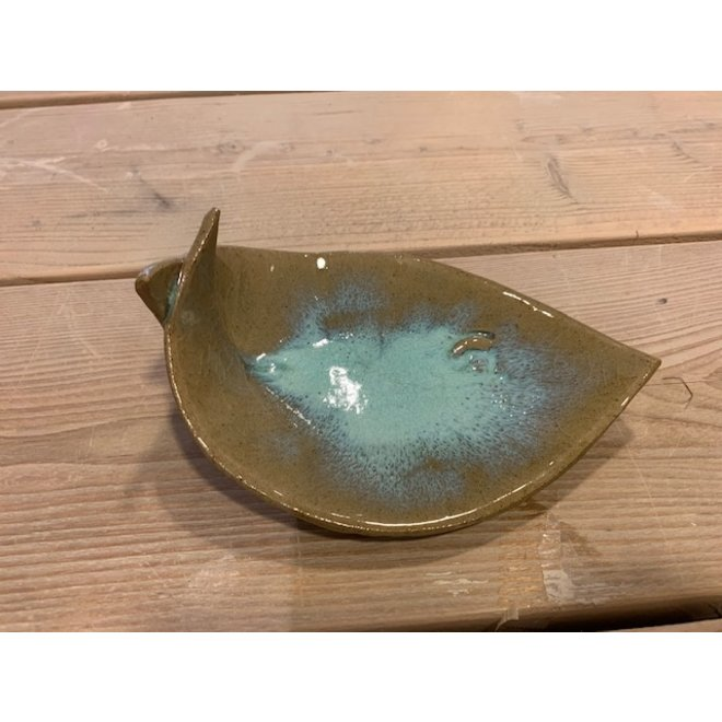 Turkoise ceramic scale in the shape of a fish. Original dish for aperitif snacks, sushi, cheese and biscuits