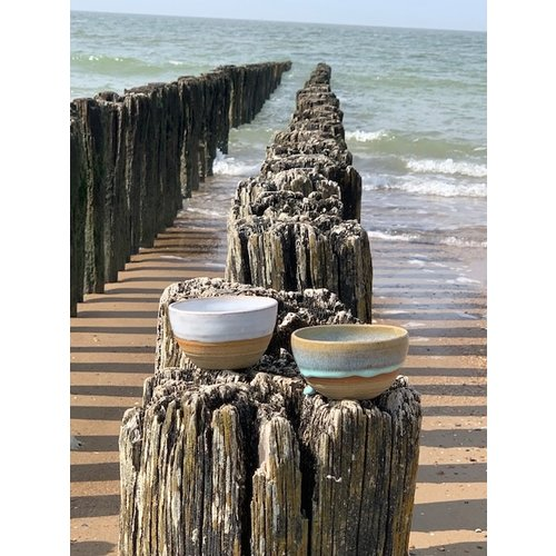 ARTISANN-design With the turntable handmade bowl of Pottery clay with a beautiful Floating light blue high-firing glaze.