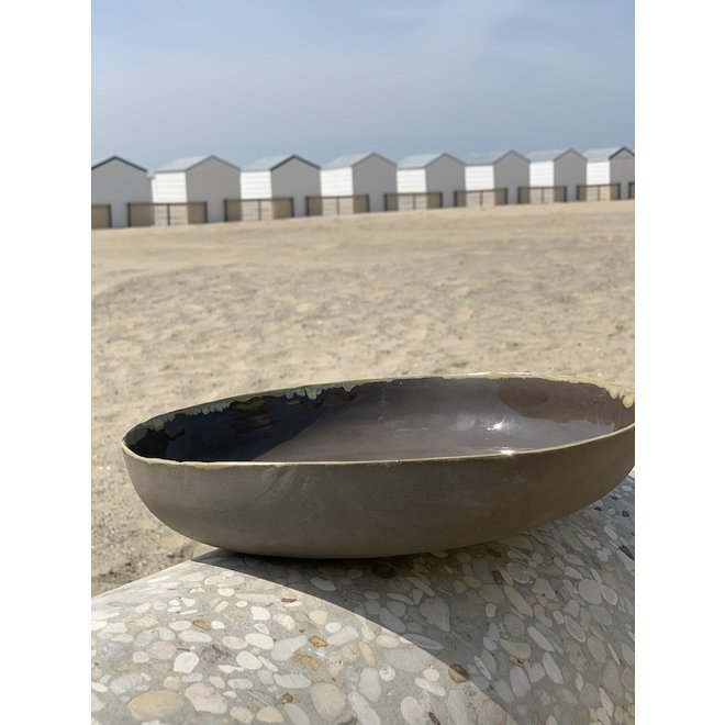 Bowl handmade in ceramic from gray clay with an ocher border