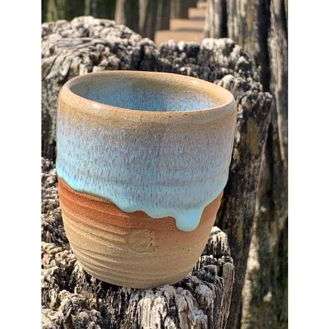 With the turntable handmade coffee cup or tea mug  of Englisch speckled Pottery Clay with a beautiful floating  turquoise high firing glaze.