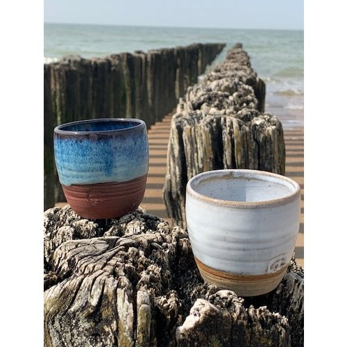 ARTISANN-design With the turntable handmade cup of Belgien red clay with a beautiful floating blue high firing glaze.