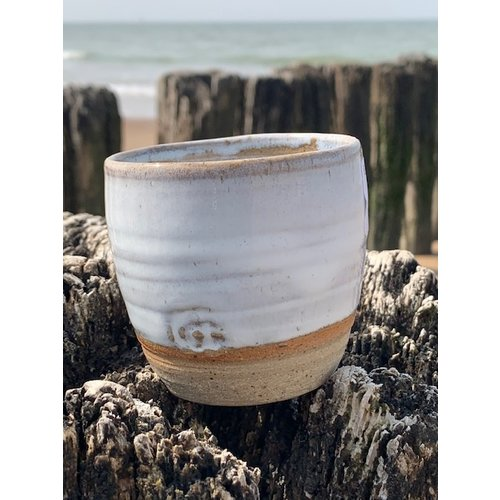 ARTISANN-design With the turntable handmade cup made with speckled Pottery clay with a beautiful opal white high firing glaze.