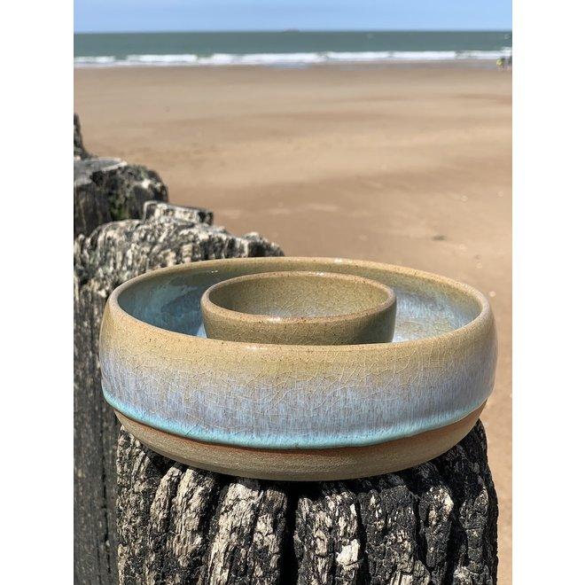 With the turntable handmade scale of Pottery clay with a beautiful floating turquoise high-firing glaze.