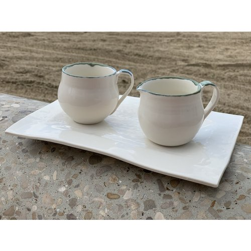 Handmade espresso porcelain cup with a green and blue edge