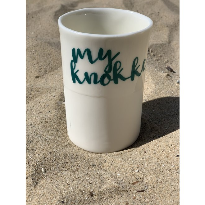 """""""My Knokke"""" with a transfer baked on a porcelain handmade bag, drinking cup, vase"""