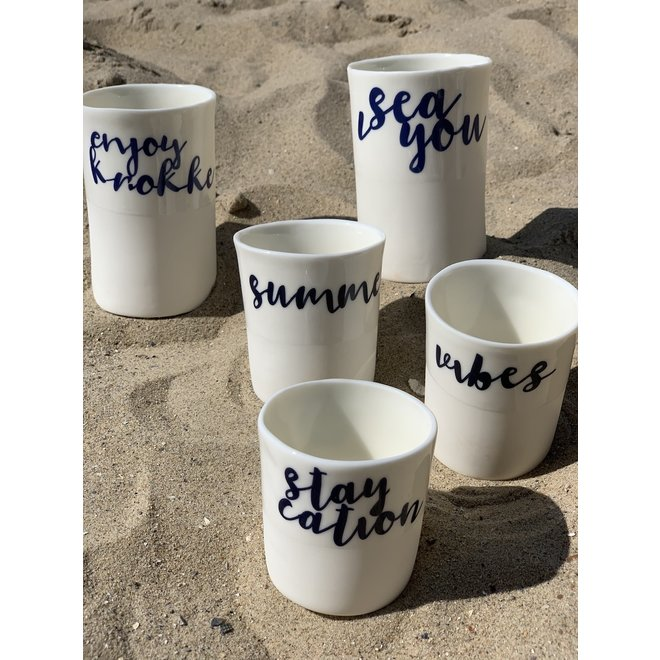 """Enjoy Knokke"" with a transfer baked on a porcelain handmade bag, drinking cup, vase"
