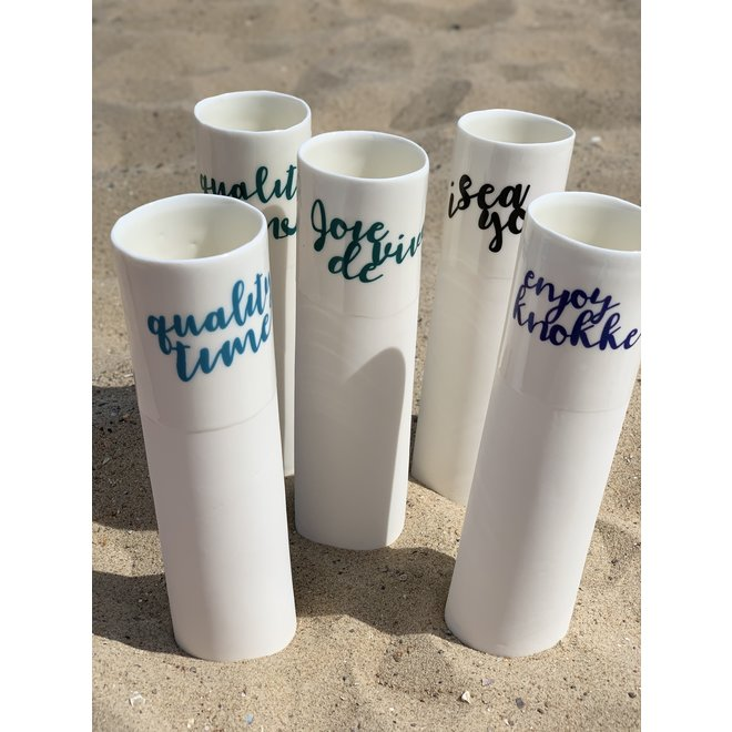 """""""Jolie Knokke"""" speak for themselves in a unique porcelain vase in cylinder form"""