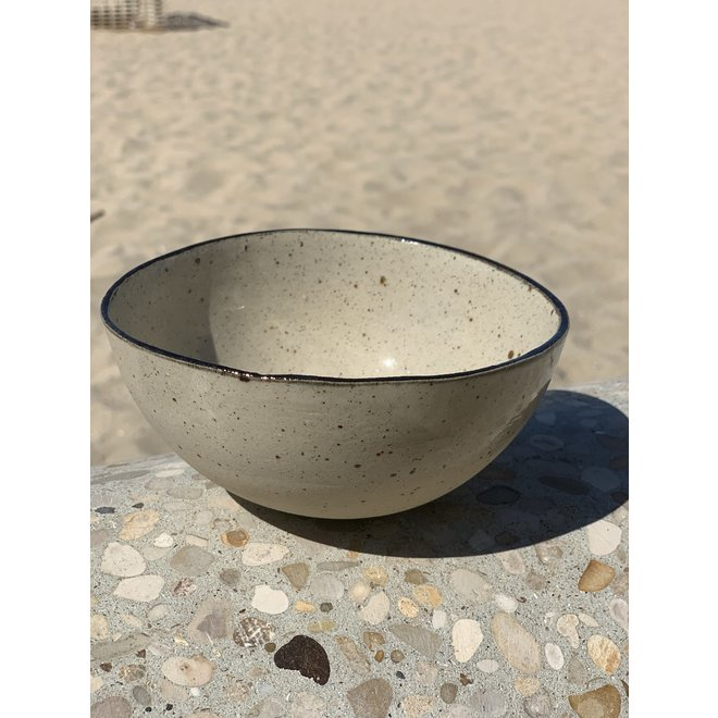 Bowl in the shape of a hemisphere handmade in ceramic with black hand-painted edge