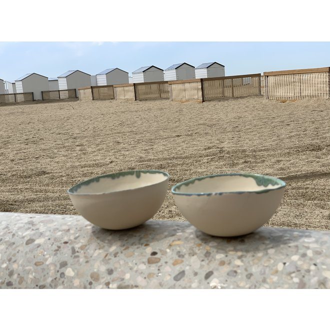 Beige bowl with green edge