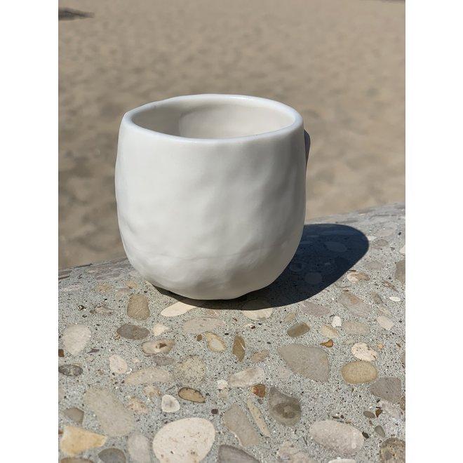 Handmade coffee bag in white porcelain