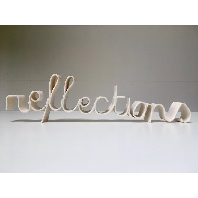 "The words ""Porcelain Reflections""  in porcelain handwriting"