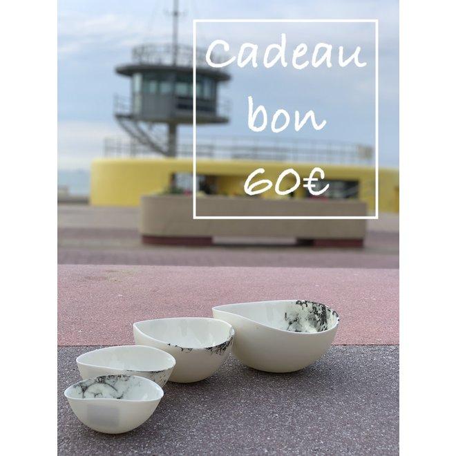 Un bon cadeau pour des céramiques artisanales de 60€ est fabriqué et offert avec beaucoup de passion et d'amour.