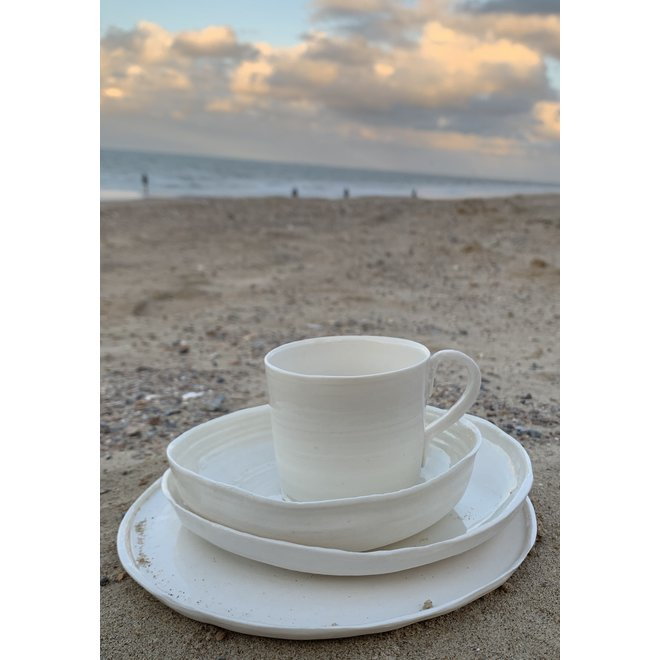 White porcelain scale. Handmade shape that exudes class and adorns its simplicity. Each little scale is unique.