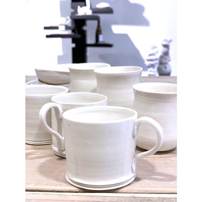 White porcelain cup. Handmade shape that exudes class and adorns its simplicity. Each cup is unique