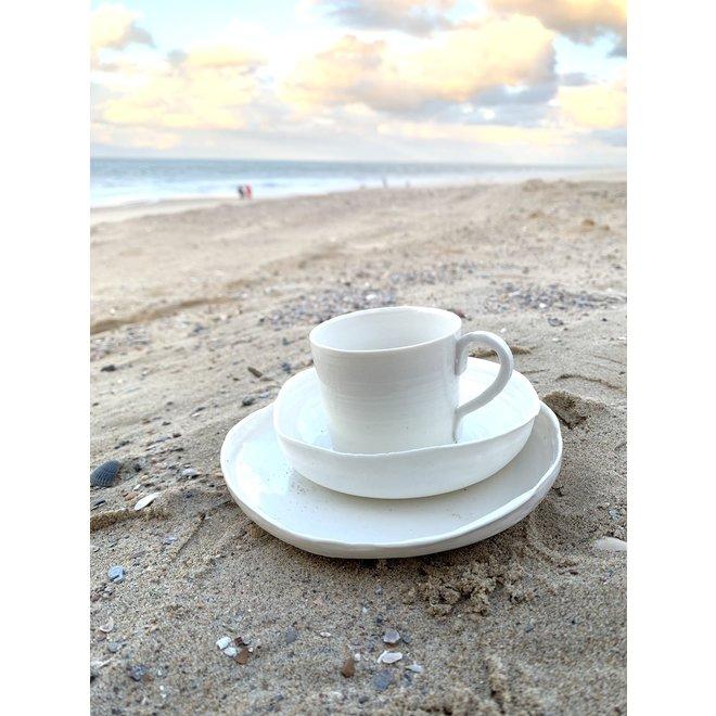 White porcelain plate. Handmade shape that exudes class and adorns its simplicity. Each plate is unique.