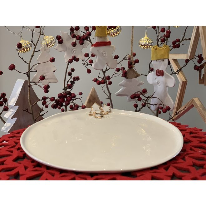 Porcelain handmade Christmas service with accents of golden stars and a Christmas tree