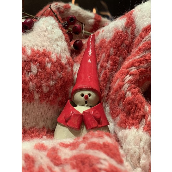 Ceramic Santa Clauses handmade with a different jacket and symbol