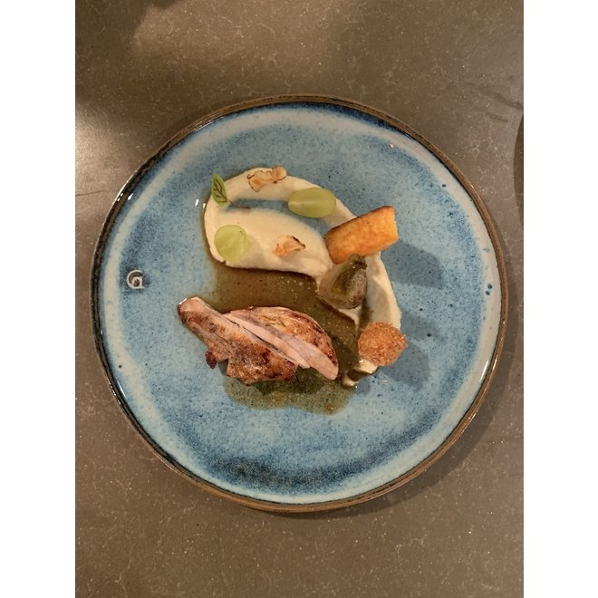 With the turntable handmade plate of Belgien clay with a beautiful Floating blue high-firing glaze.