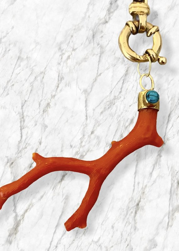 Unpolished coral branch with turquoise