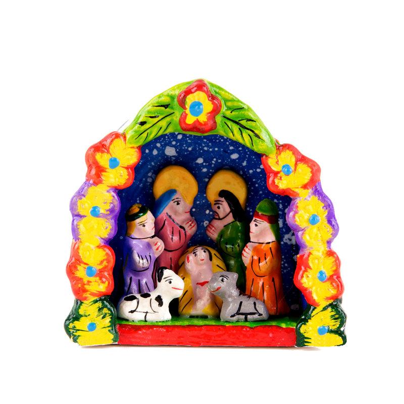Nativity scene in arch of flowers, medium