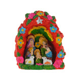 Nativity scene in stone niche, red