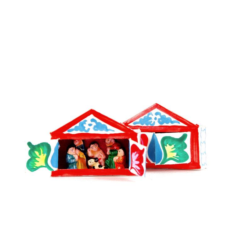 Kerststalletje in mini-luciferdoosje