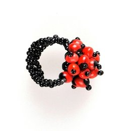 Ring with small flower of orange wayruro beads