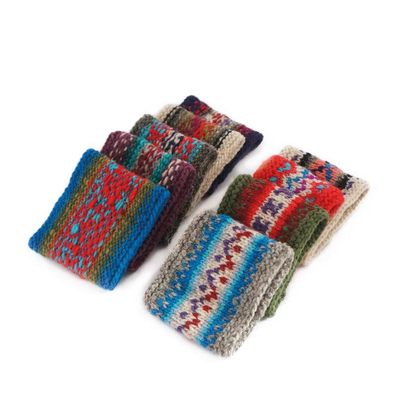 Wide knitted bracelet, Inca-motifs 100 % wool
