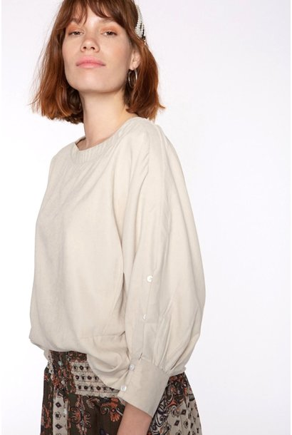 Blouse with buttons in sleeve