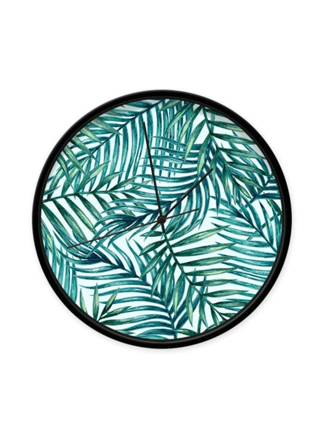 Clock with print of tropical leafs