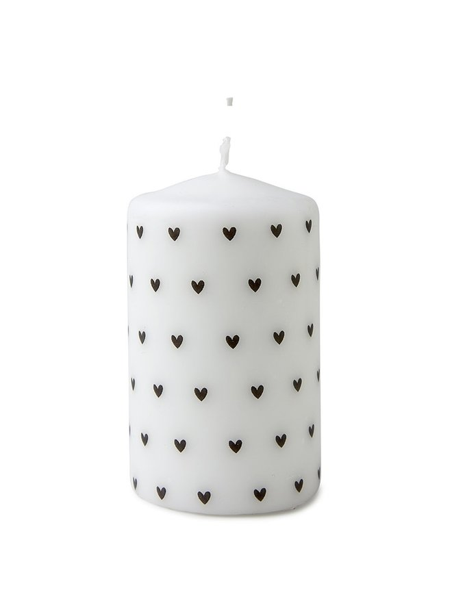 Candle with hearts pattern