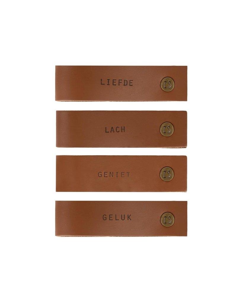 ZUSSS Zusss set van 4 leren servetringen met tekst bruin