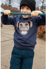 Dyr Blauwe trui met chimpansee aap